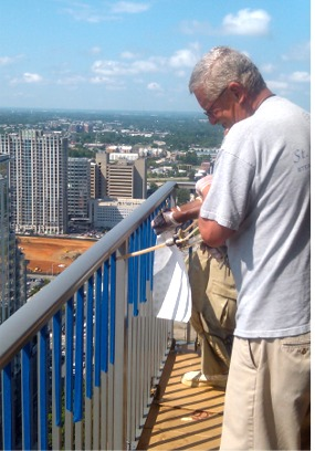 Injecting Foam into High Rise Railing